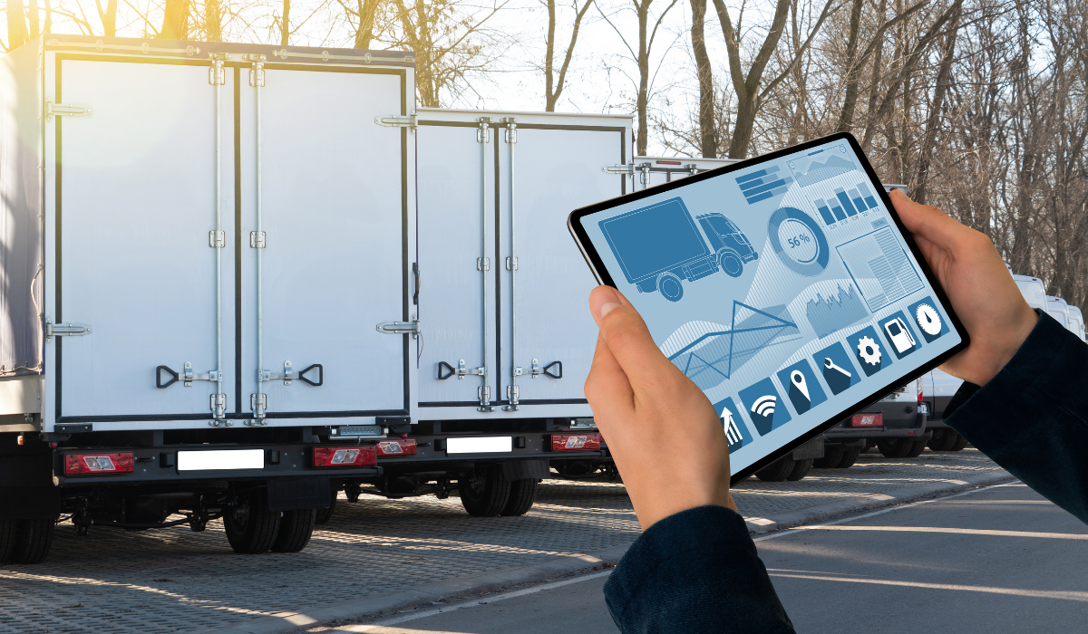 Man holding a tablet and moving trucks